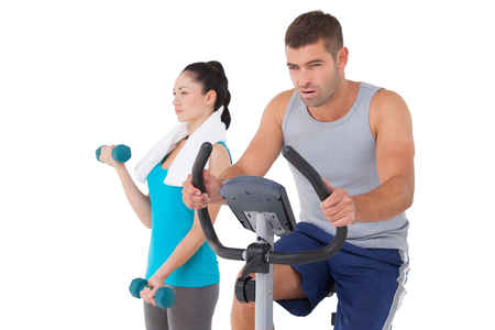 Man and woman working out on white background