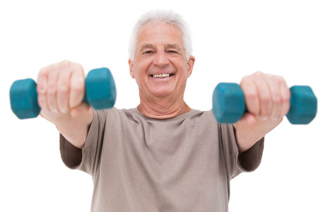hand weights: Senior man lifting hand weights on white background Stock Photo