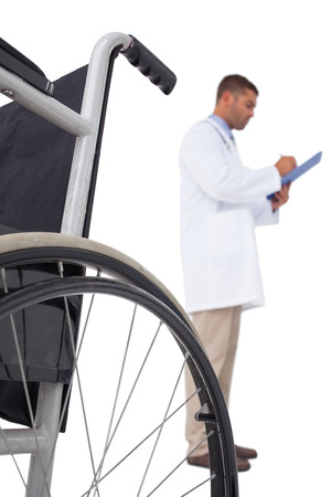 doctor writing: Doctor writing on clipboard on white background Stock Photo
