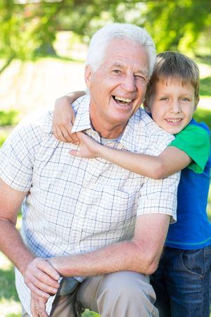grand father: Happy grand father with his grandson on a sunny day Stock Photo