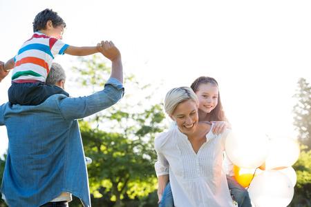 family activities: Happy family walking at the park