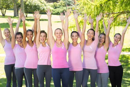 breast cancer awareness ribbon: Smiling women in pink for breast cancer awareness on a sunny day