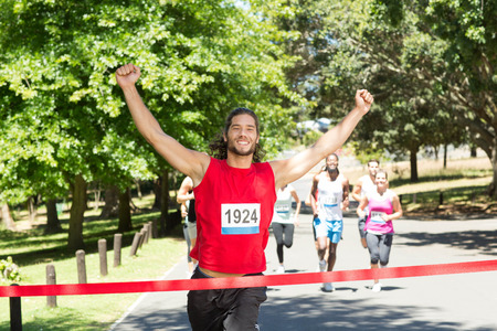 Fit people running race in park on a sunny day Banco de Imagens