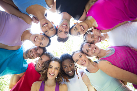 men women: Fitness group smiling at camera in park on a sunny day Stock Photo