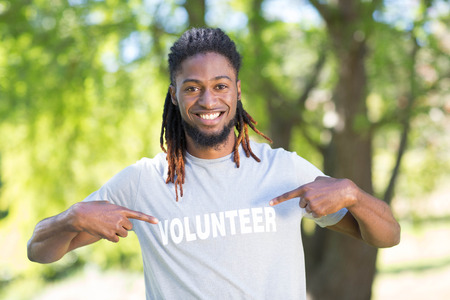 Happy volunteer in the park on a sunny day