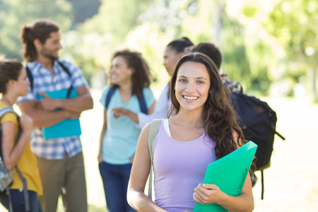 college campus: Smiling students on college campus on a sunny day