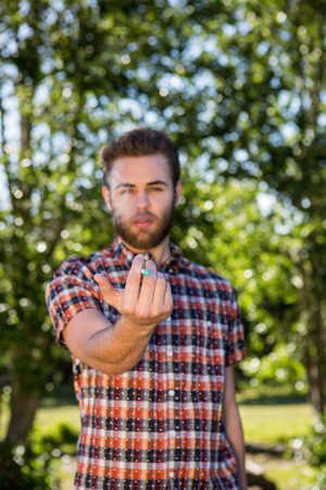summers: Hipster smoking an electronic cigarette on a summers day Stock Photo