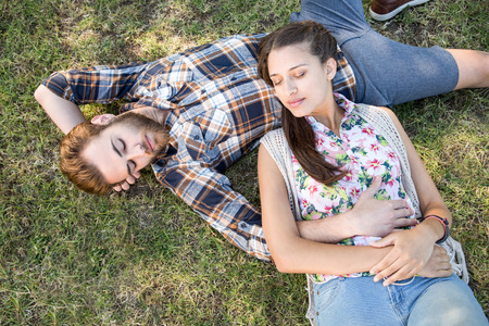 summers: Young couple relaxing in the park on a summers day