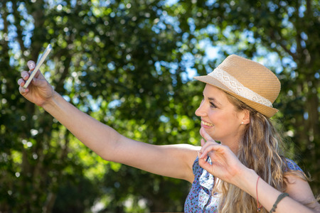 summers: Pretty blonde taking a selfie on a summers day Stock Photo