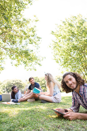 revising: Classmates revising together on campus on a summers day Stock Photo