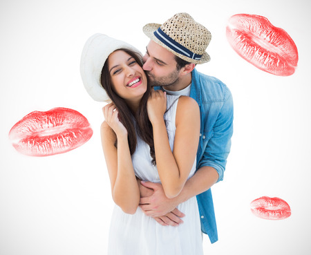 Happy hipster couple hugging and smiling against white background with vignette photo