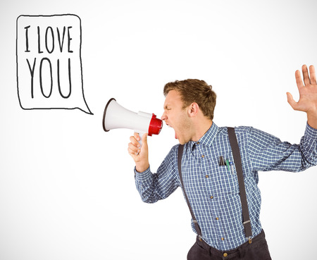 Geeky hipster shouting through megaphone against white background with vignette photo