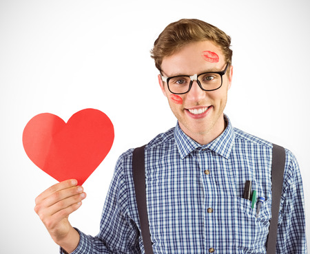 geeky: Geeky hipster holding a heart card against white background with vignette