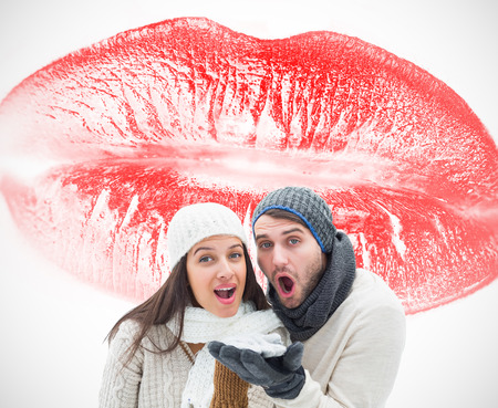 Young winter couple against white background with vignette photo