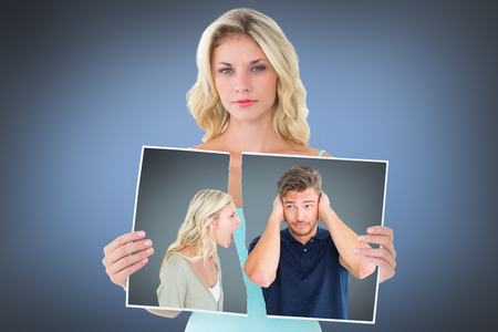 Man not listening to his shouting girlfriend against grey vignette photo