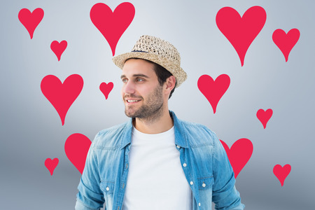 chinos: Handsome hipster wearing a trilby against grey vignette