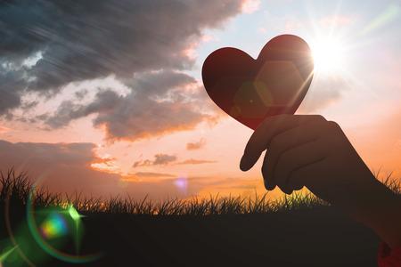 against the sun: heart against sun set Stock Photo