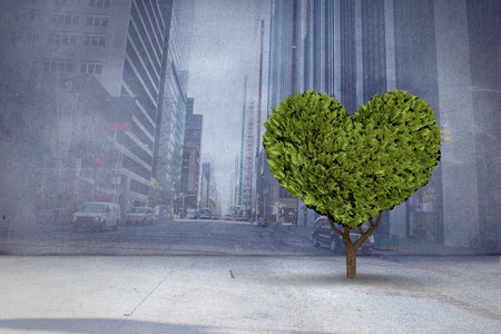 projection: Heart shaped plant against urban projection on wall Stock Photo