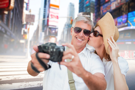 vacationing: Vacationing couple taking photo against blurry new york street
