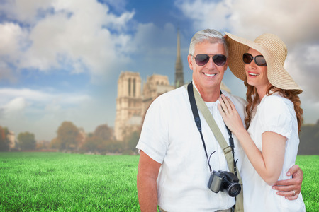vacationing: Vacationing couple against notre dame cathedral