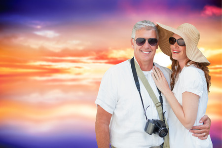 vacationing: Vacationing couple against purple sky with orange clouds