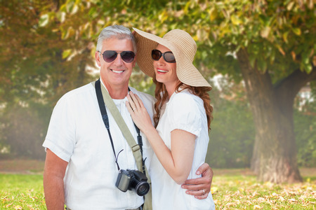 vacationing: Vacationing couple against trees and meadow in the park