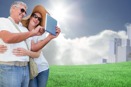 vacationing: Vacationing couple taking photo against cityscape on the horizon Stock Photo