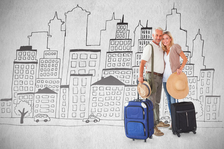 Happy couple ready to go on holiday against white background photo