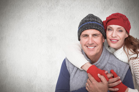warm clothing: Happy couple in warm clothing against white background Stock Photo