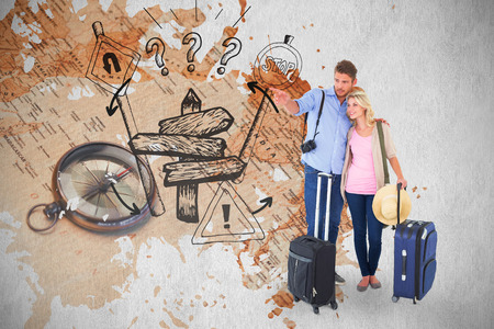 Attractive young couple ready to go on vacation against world map with compass showing southern asia photo