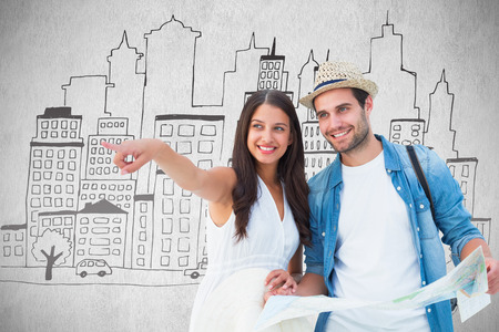 Happy hipster couple looking at map against white background photo