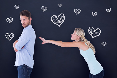 argument from love: Desperate blonde reaching for boyfriend against blackboard