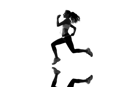 full length mirror: Full length of healthy woman jogging  against mirror Stock Photo