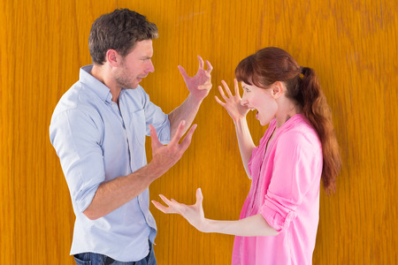 fighting styles: Couple arguing with each other against wooden pine table