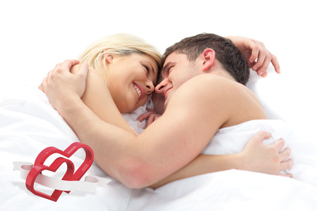 linking: loving Couple relaxing on bed  against linking hearts Stock Photo