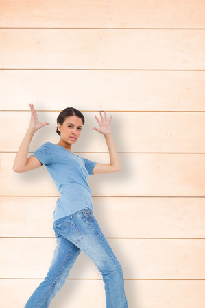pale wood: Annoyed brunette gesturing against wooden background in pale wood
