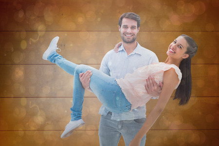 Attractive young couple having fun against dark abstract light spot design