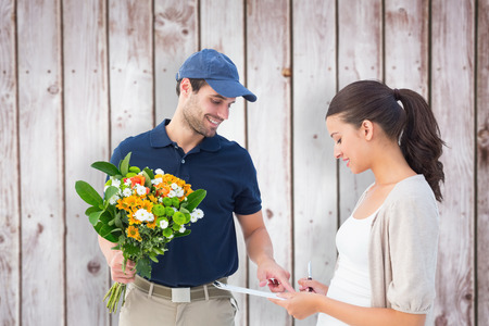 Happy flower delivery man with customer against wooden planks photo