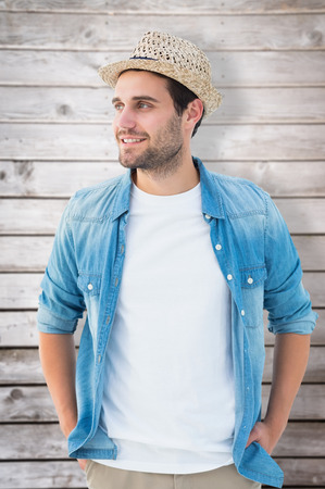 chinos: Handsome hipster wearing a trilby against wooden planks