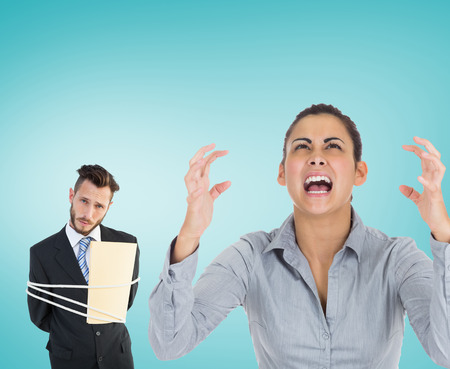 Furious businesswoman gesturing against blue vignette background photo