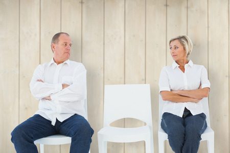not talking: Upset couple not talking to each other after fight against wooden planks Stock Photo