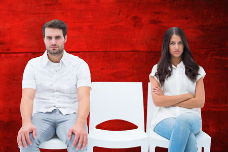not talking: Angry couple not talking after argument against red wooden planks