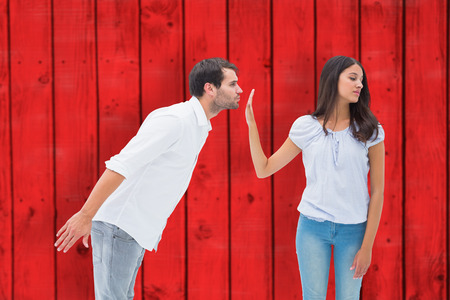 uninterested: Brunette uninterested in mans advances against red wooden planks Stock Photo