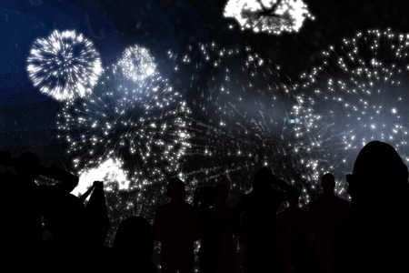 incidental people: Silhouette of cheering people against white fireworks exploding on black background