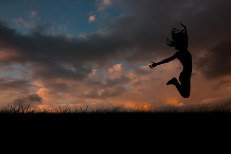incidental people: Silhouette of woman jumping against cloudy sky Stock Photo