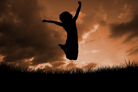incidental people: Silhouette of little girl jumping against cloudy sky