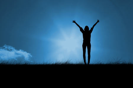 incidental people: Silhouette of cheering woman against blue sky over grass Stock Photo
