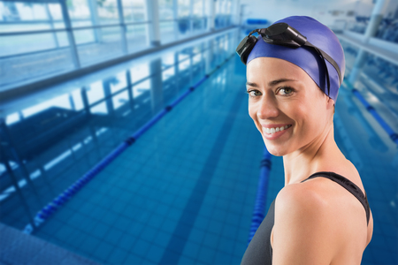 lane marker: Fit swimmer standing by the pool smiling at camera against empty swimming pool with lane markers Stock Photo