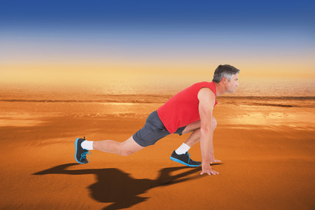 hazy: Fit man stretching his legs against hazy blue sky Stock Photo