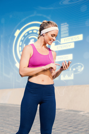 promenade: Fit blonde standing on the promenade against fitness interface